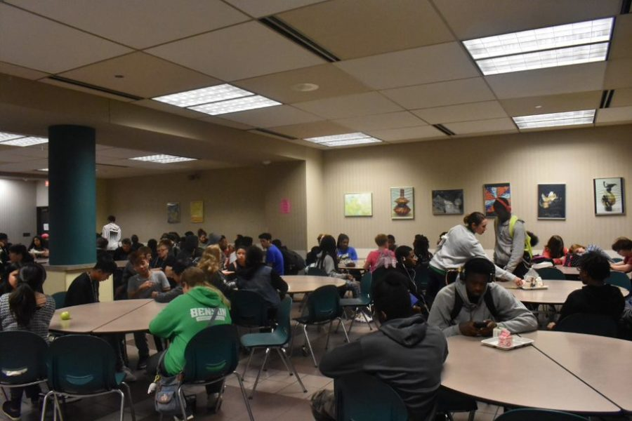 Freshman and sophomores eating in the cafeteria.